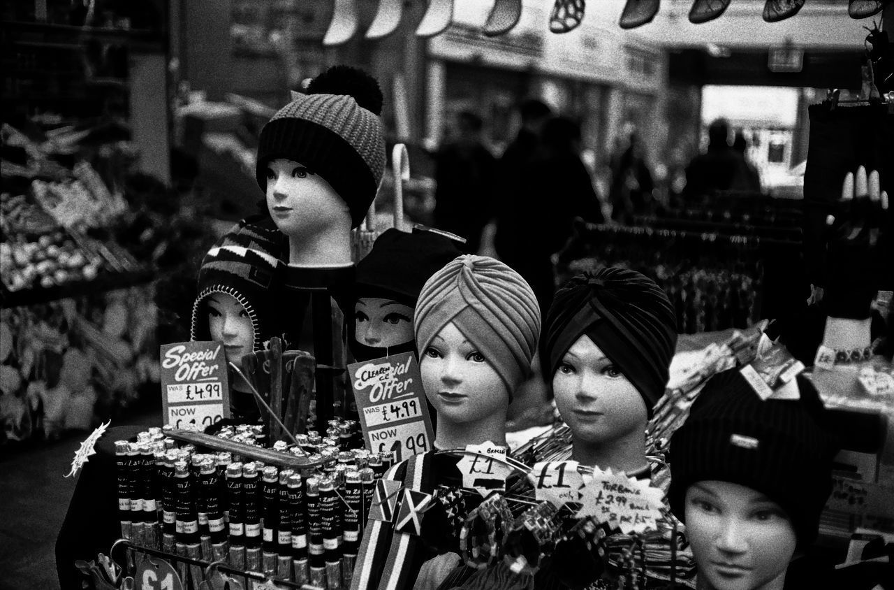 Wooly Hats & Turbans Black And White Photography Casual Clothing Documentary Nature Photography Photography Taking Photos A Dummy Heads Enjoyment Family Focus On Foreground Friendship Fun Head Gear Leisure Activity Lifestyles Market Brixton Monochrome Monochrome _ Collection Outdoors Portrait Reportage Street Photos Taking Fotos Images Photographic Camera Lens Architectural Design Building Structual Support Detail Of Tower Block In Sunshine Blue Sk Wooly Hats And Turbans