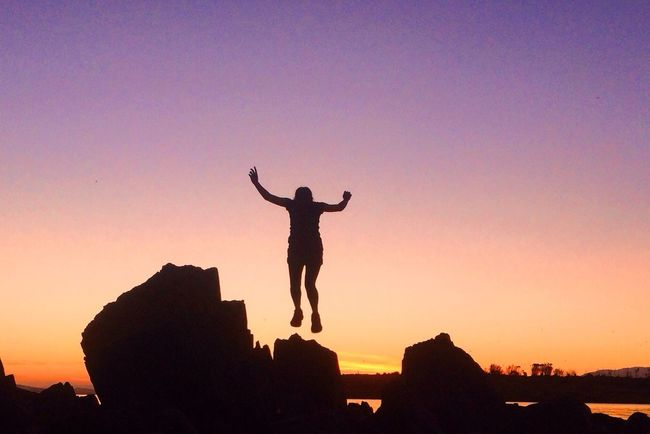 Jumping for the sunset. Impossible Moments Jumping Nature