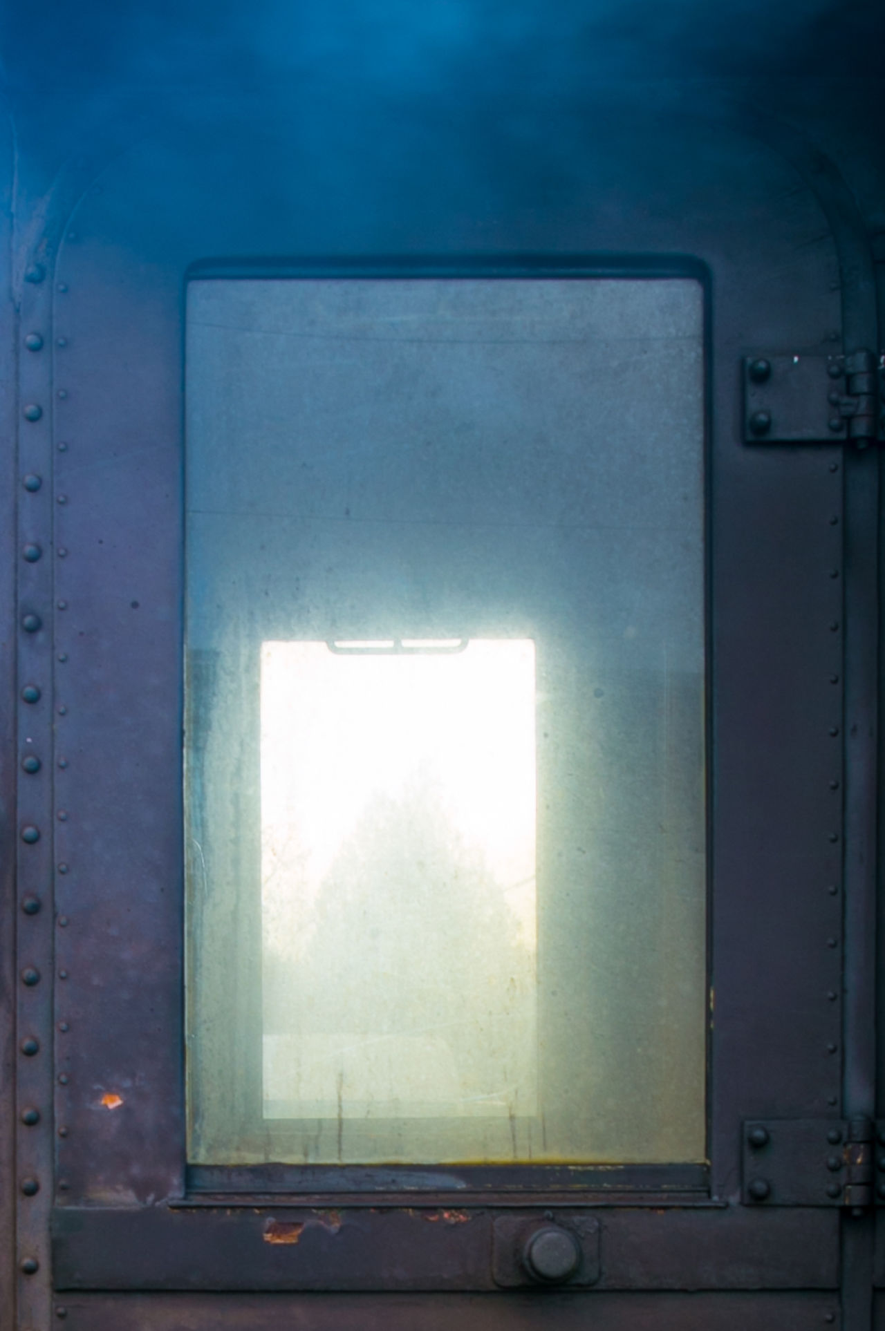 Old steam engine's door. Blue Cold Door Fog Forms Glass Historical Metal Metallic No People Old Outside Outside Inside Repetition Rivets Steam Steam Engine Steam Train Steamy Train Warm Window Windows Yellow