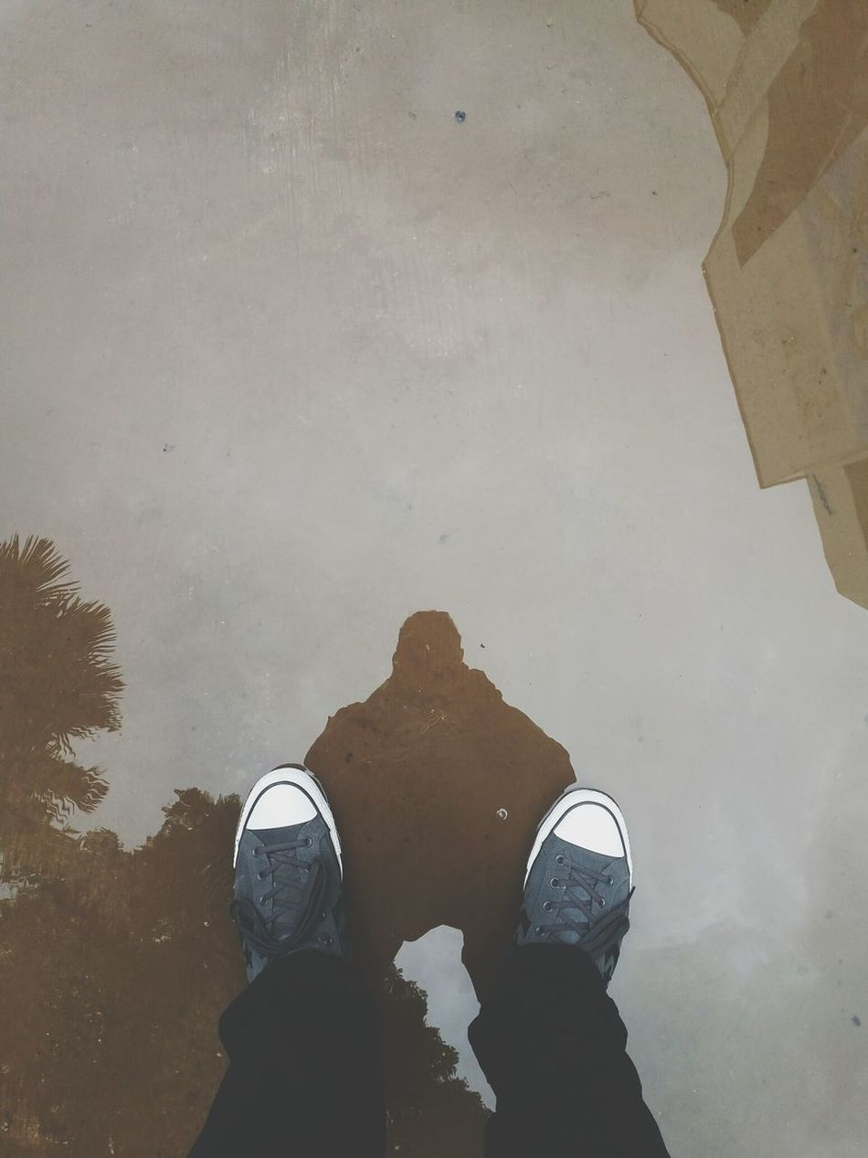 """""""if you want to make the world a better place, take a look at yourself and make a change"""" -Michael Jackson Low Section Shoe Person Standing Personal Perspective Men Footwear Reflection Puddle Water Human Foot Day In Front Of Standing Water EyeEm Philippines Eyeem Philippines Rain Puddle Reflections Samsung Galaxy Camera Converse"""