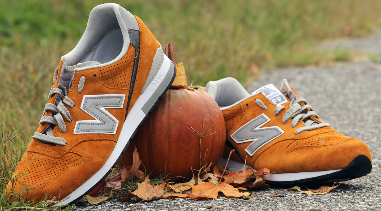 Newbalance sneakers. Brown Close-up Day Field NewBalance No People Orange Color Out Of The Box Outdoors Sneaker Sneakers