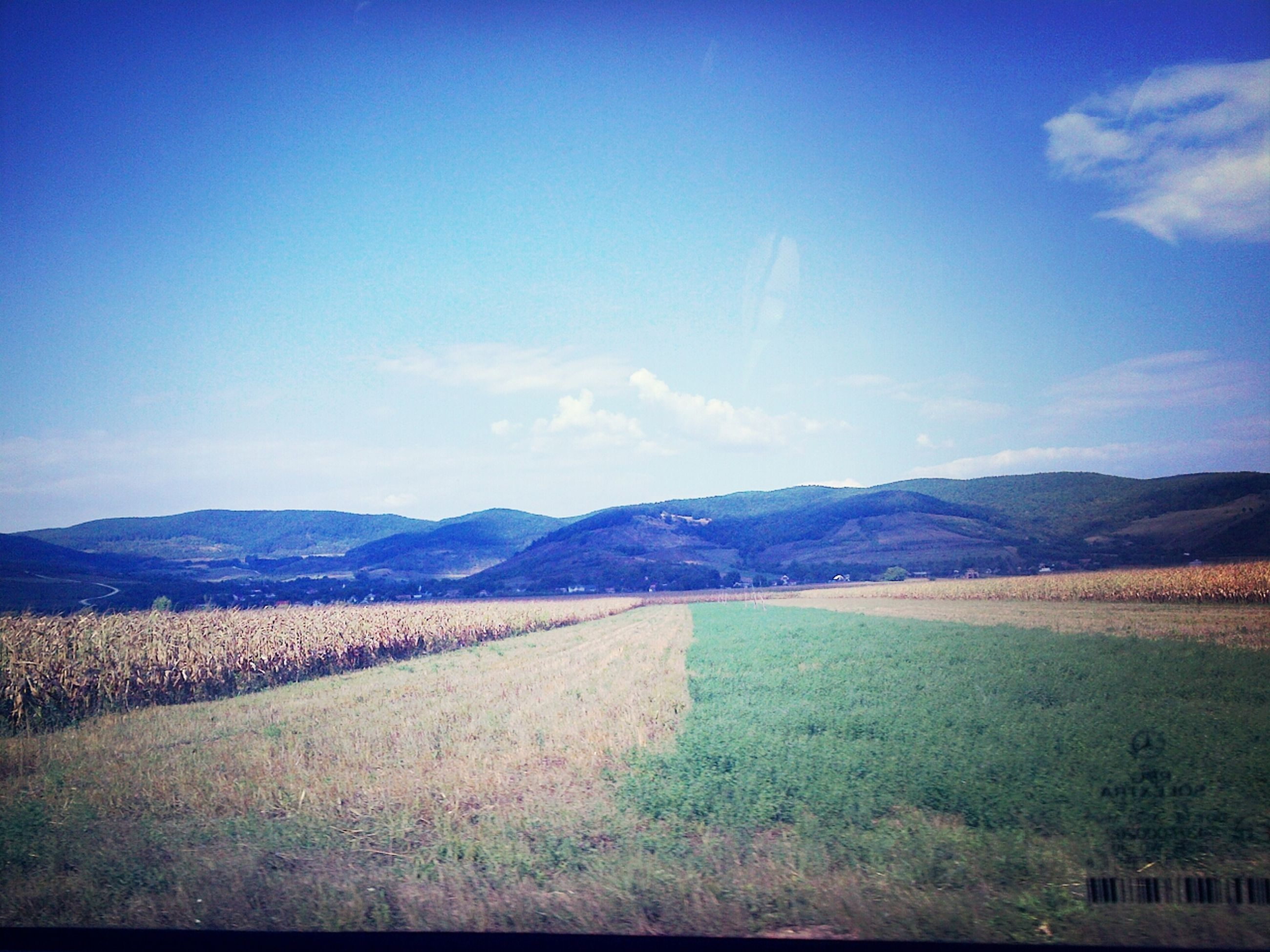 landscape, mountain, tranquil scene, tranquility, scenics, mountain range, blue, sky, beauty in nature, nature, non-urban scene, field, grass, countryside, remote, copy space, hill, road, idyllic, horizon over land