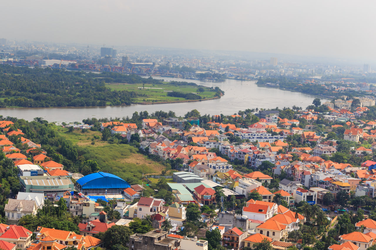 Hochiminh City, Vietnam - October 21, 2013: A view of HoChiMinh city panorama from above. This is a new residential area with many villas was built at a rapid pace beside the Saigon River. Apartment Architecture ASIA Brochure Building Built Structure Business Canal Cargo Container Container Ship Culture Destination Harbor Morning Panoramic Retail  Ship Skyline Tower Travel Urban Scene Vacation Villa Warehouse