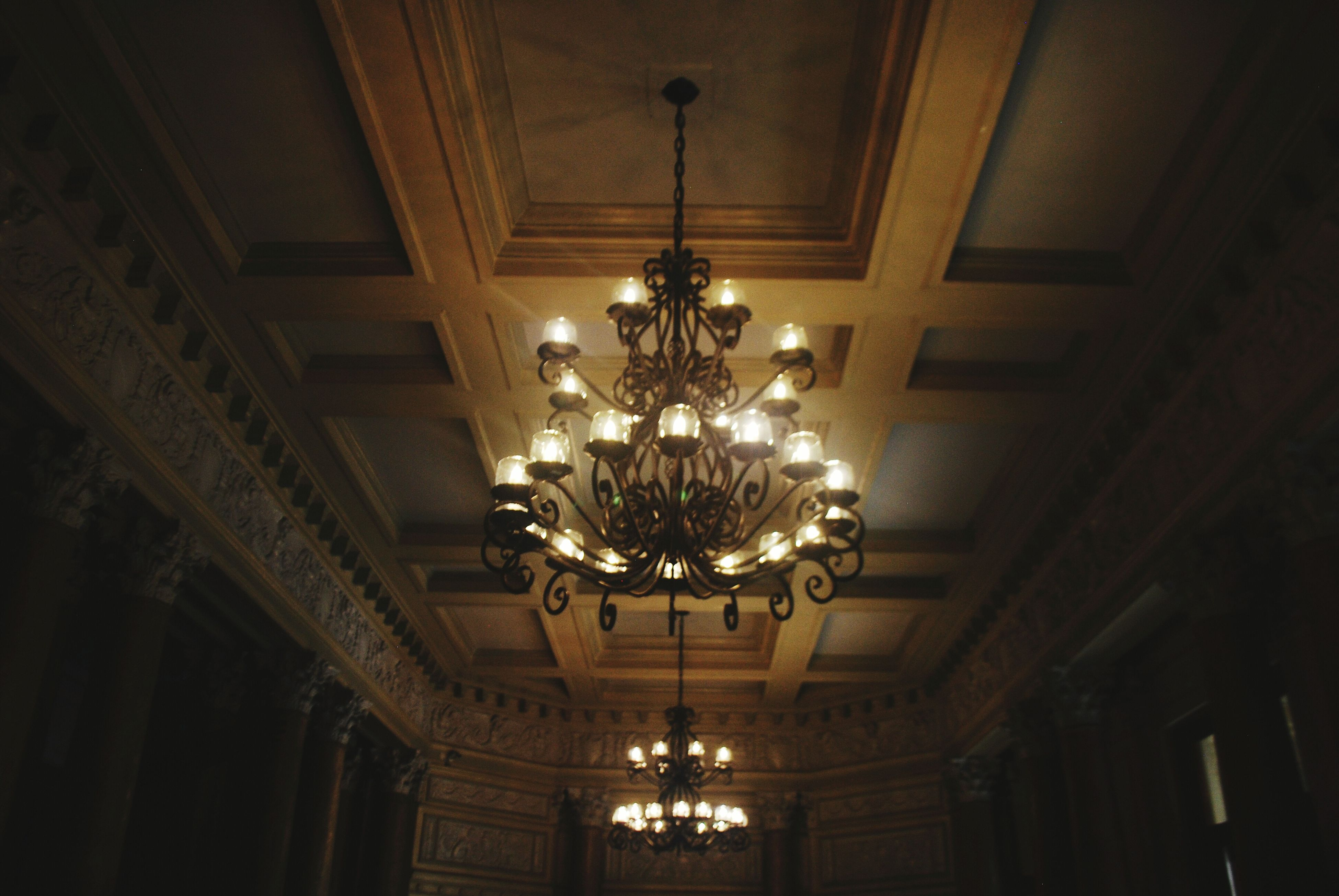 indoors, ceiling, lighting equipment, illuminated, hanging, chandelier, low angle view, decoration, electric lamp, electricity, electric light, architecture, luxury, built structure, hanging light, decor, light bulb, ornate, pendant light, light - natural phenomenon