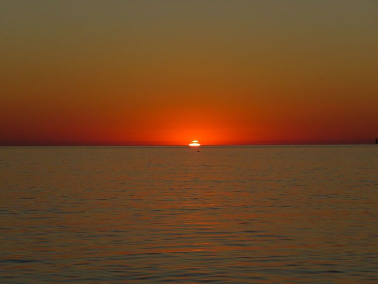 Horizon Over Water Sea Sunset Scenics Water Tranquil Scene Beauty In Nature Sun Orange Color Waterfront Seascape Nature Vibrant Color Ocean Sky