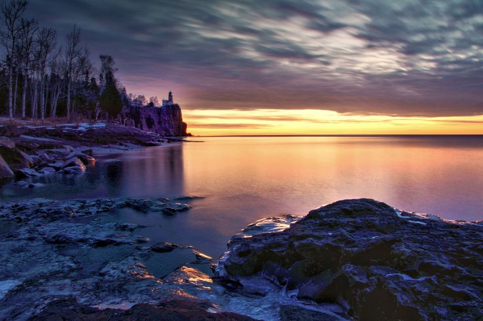 Morning at Split Rock Lighthouse Nature Beauty In Nature Water Sky Scenics No People Tranquil Scene Sunset Outdoors Rock - Object Tranquility Sea Beach Cloud - Sky Day Lake Superior Malephotographerofthemonth Streamzoofamily Lighthouse Winter Sunrise Sunrise_sunsets_aroundworld