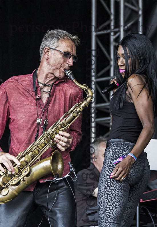 Heather Small of M People fame performs at a free concert in Bents Park, South Shields, UK, with Snake Davis on saxophone. Artist Concert Gig Heather Small M People Performance Saxophone Saxophonist Singer  Snake Davis Uk Festival Season Music Brings Us Togheter