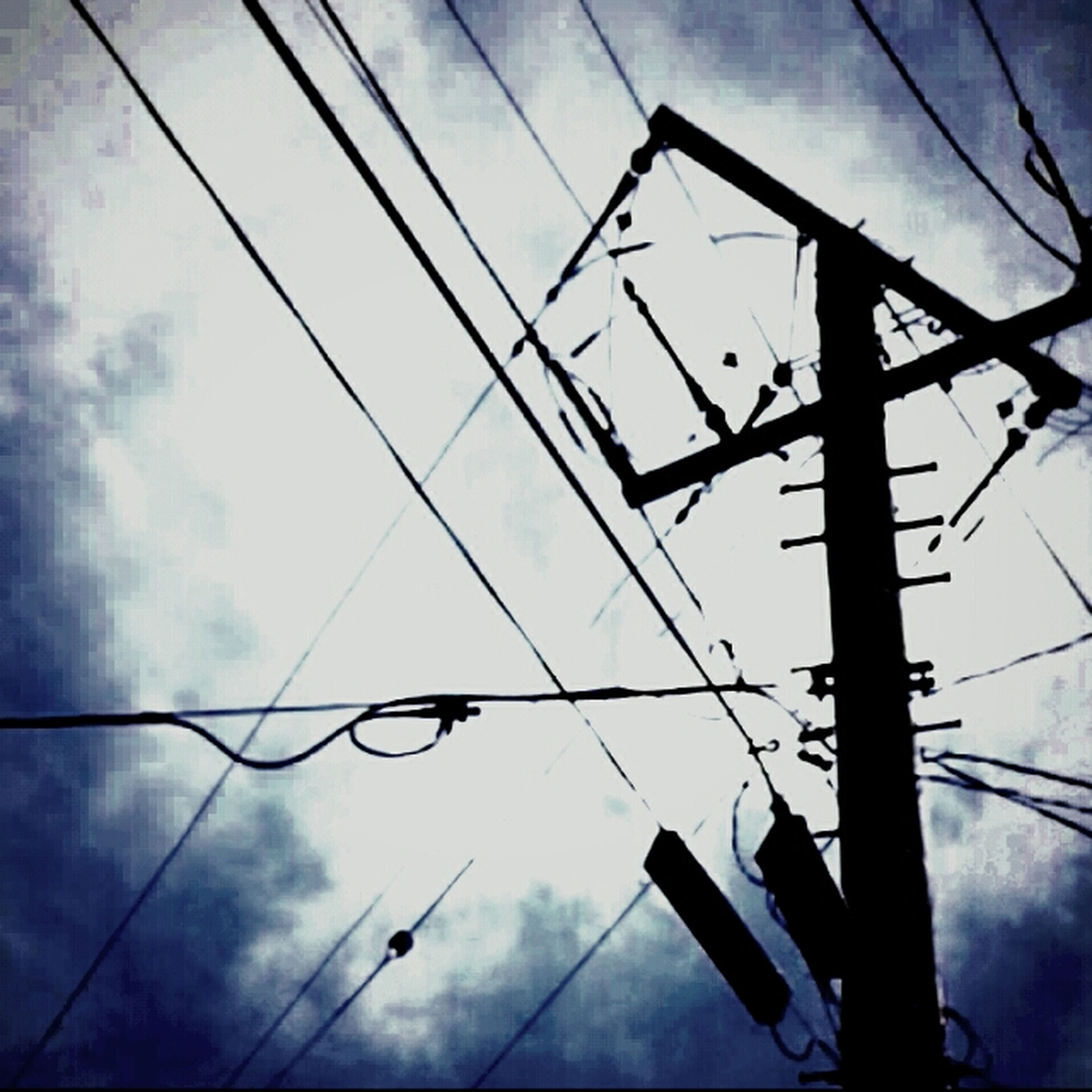 low angle view, power line, sky, cable, silhouette, power supply, electricity, connection, cloud - sky, technology, fuel and power generation, electricity pylon, cloudy, pole, cloud, power cable, transportation, outdoors, communication, no people