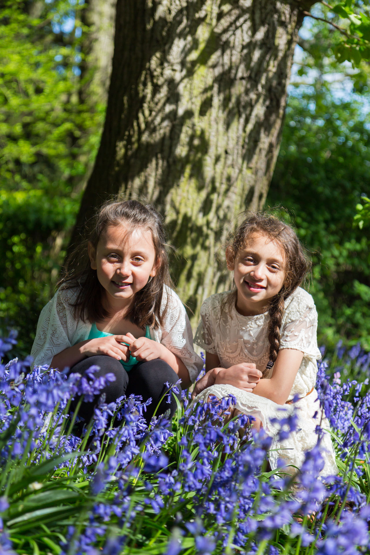 Happy cute sisters, Children in a park in Leicester having a good time. Blur Background Caring Sisters Children Photography Day Daytime Flowers,Plants & Garden Happy Kids Interactions Loving Sisters Lush Foliage Outdoors Outside Photography Playing Games Portraits Rural Scene Sisters Young Female