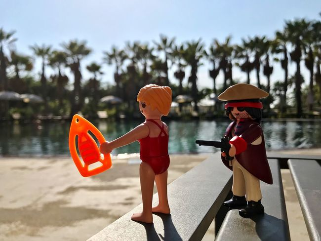 Childhood Two People Sunlight Outdoors Day Focus On Foreground Leisure Activity Vacations Boys Real People Shadow Togetherness Full Length Lifestyles Tree Water Nature Sky People Playmobil Palm Trees Swimming Pool