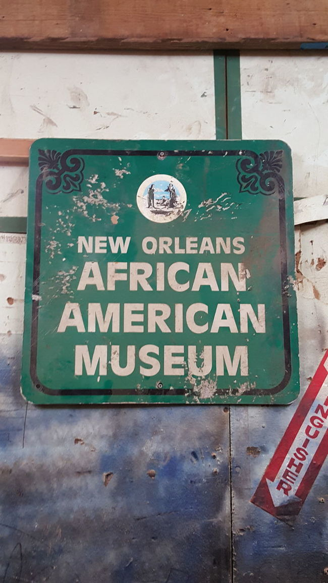 African American African American Museum Black History Month Capital Letter Communication Direction Guidance Human Representation Information Information Sign Non-western Script Number Road Sign Sign Symbol Text Wall Warning Sign Western Script