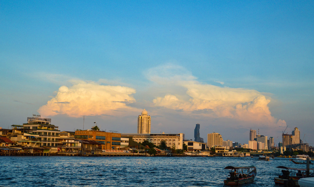 architecture, building exterior, built structure, sky, city, water, cityscape, waterfront, cloud - sky, nautical vessel, skyscraper, outdoors, sea, day, no people, urban skyline, nature