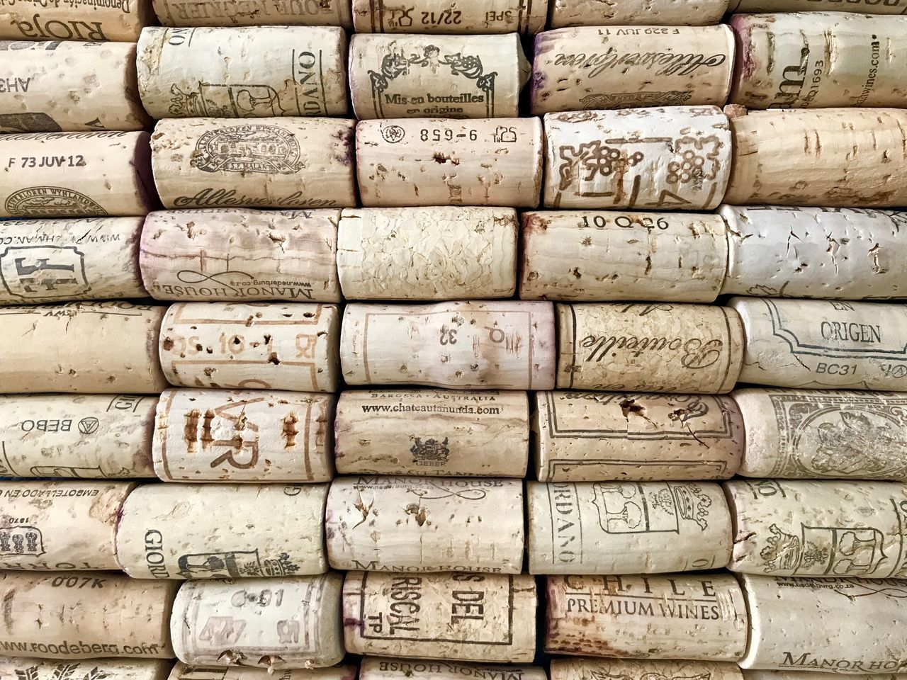 Backgrounds Wine Cork Full Frame Stack Cork - Stopper In A Row Communication Arrangement Text Large Group Of Objects Textured  Wine Close-up Barrel No People Indoors  Wine Cask Day