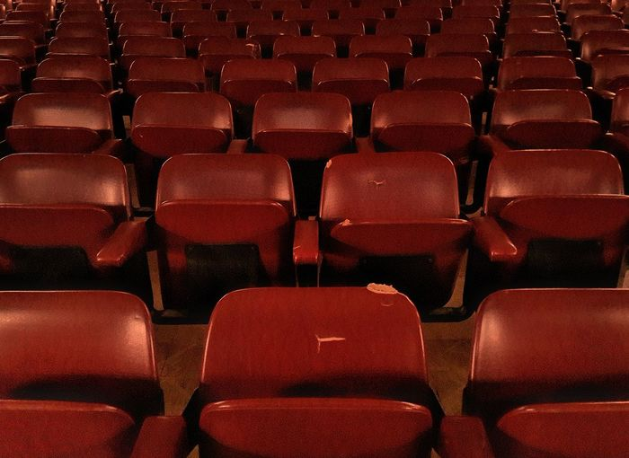 Red In A Row Seat Empty Repetition ChairIndoors  Stage Theater Film Industry MOVIE Large Group Of Objects Entertainment Theater Full Frame Auditorium No People