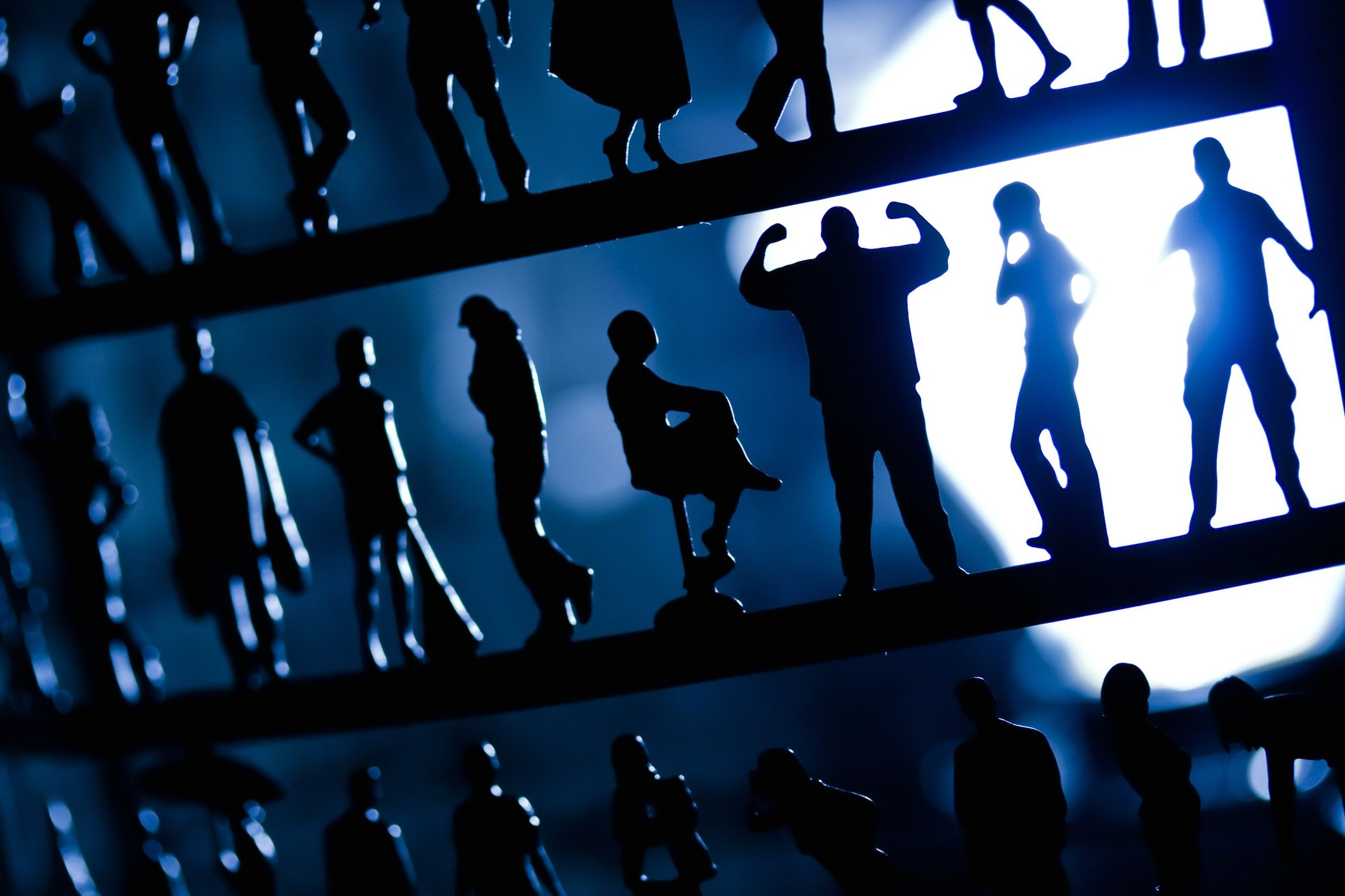 large group of people, men, crowd, lifestyles, silhouette, indoors, music, togetherness, person, in a row, leisure activity, performance, standing, arts culture and entertainment, side by side, night, illuminated, low angle view