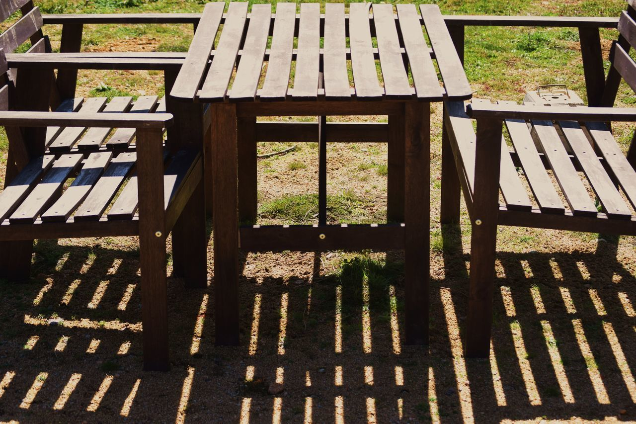 High Angle View Of Chairs And Table On Sunny Day