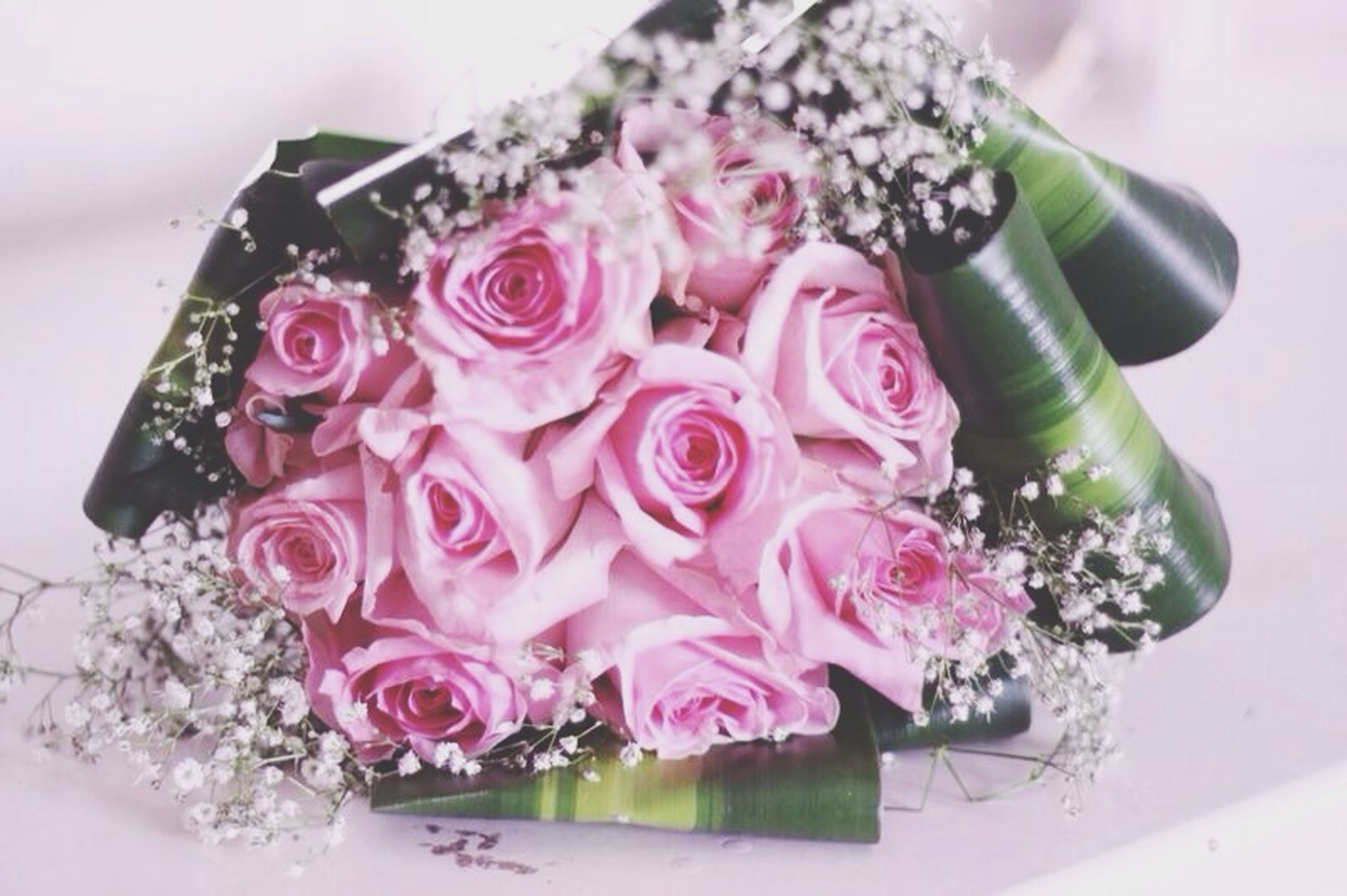 indoors, flower, freshness, close-up, still life, table, rose - flower, pink color, focus on foreground, fragility, petal, no people, decoration, bunch of flowers, vase, beauty in nature, selective focus, high angle view, flower head, nature