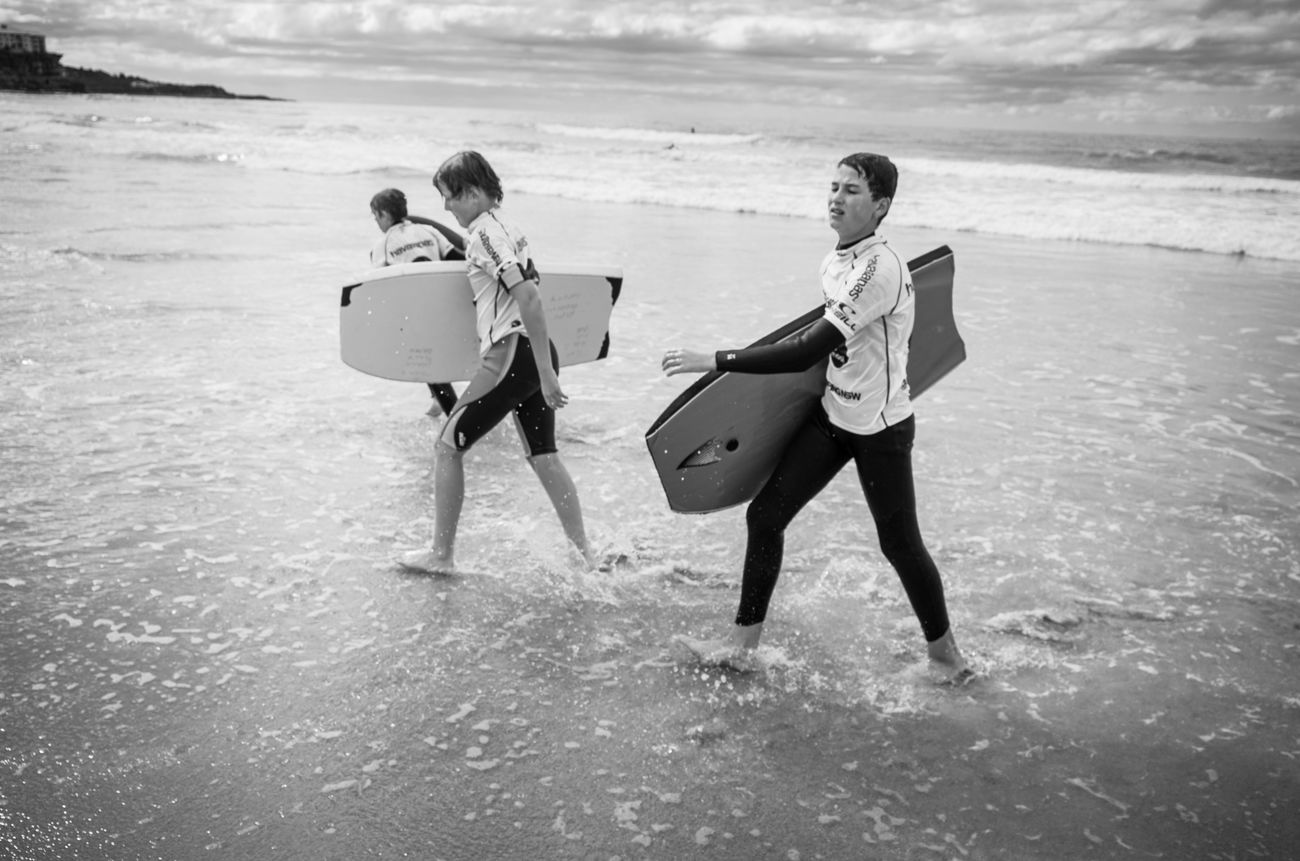 Surfers. Beach People Sea Street Photography Rawstreets Lifestyles Real People Maxgor Maxgor.com Leica X Vario Sydney Australia Black And White Photography Black And White Monochrome Photography Water The Street Photographer - 2017 EyeEm Awards BYOPaper! Live For The Story