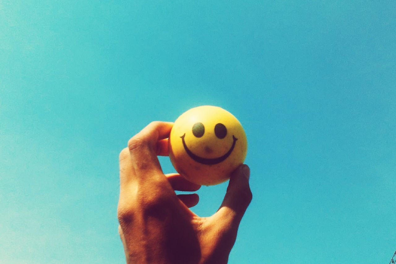 Smile Holding Person Blue Food And Drink Copy Space Part Of Freshness Close-up Unhealthy Eating Creativity Smile Personal Perspective Pelota Sonrisa Minimalism Minimal