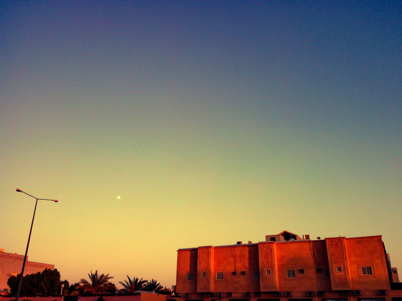 sunset, low angle view, architecture, built structure, building exterior, no people, sky, outdoors, clear sky, nature, day