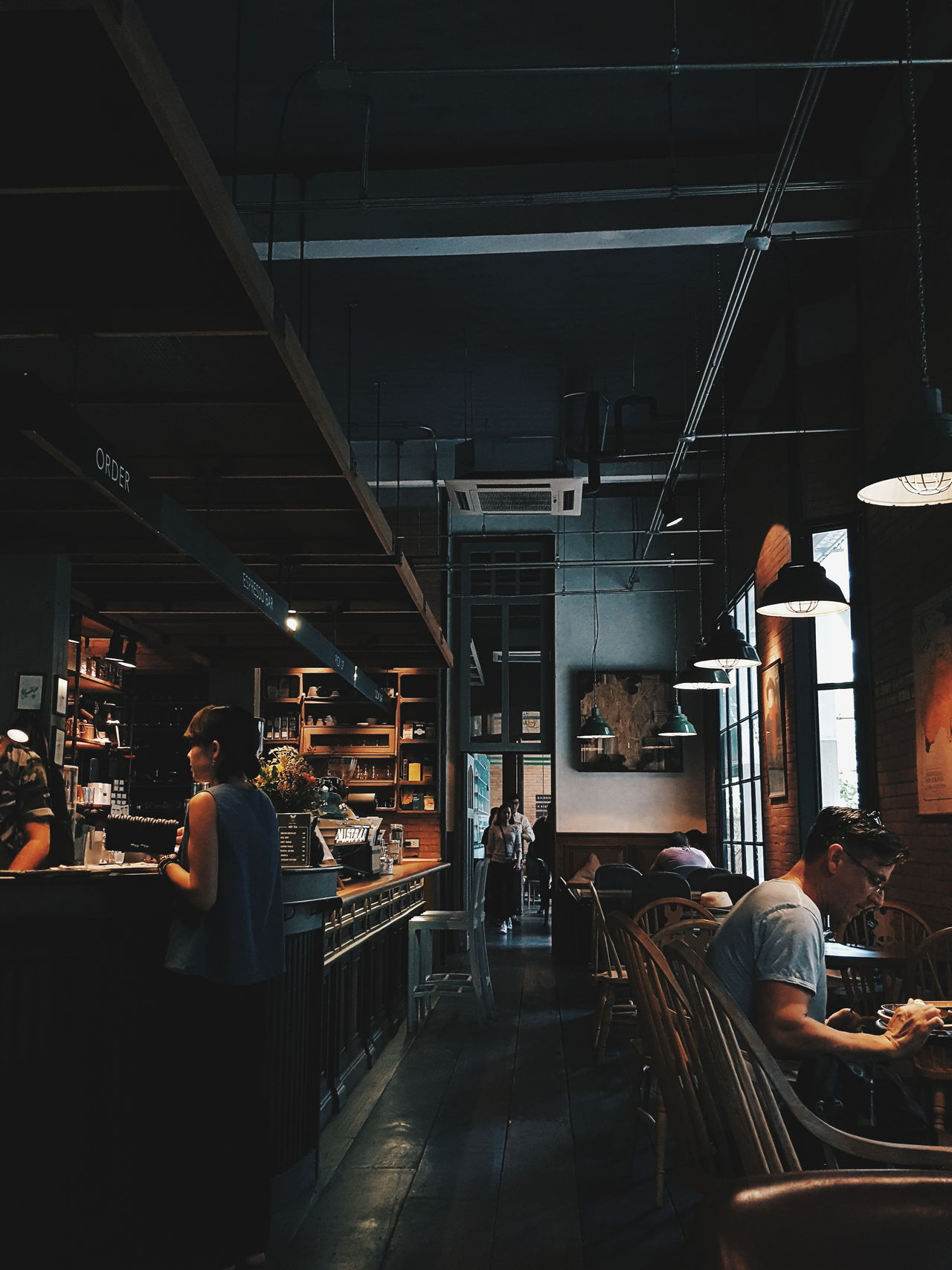 Cafe life in Bangkok Indoors  People Occupation VSCO Bokeh Cool Hipster Mood Indoors  Cultures Cafe Coffee Ambience Dark Chill Bangkok Thailand