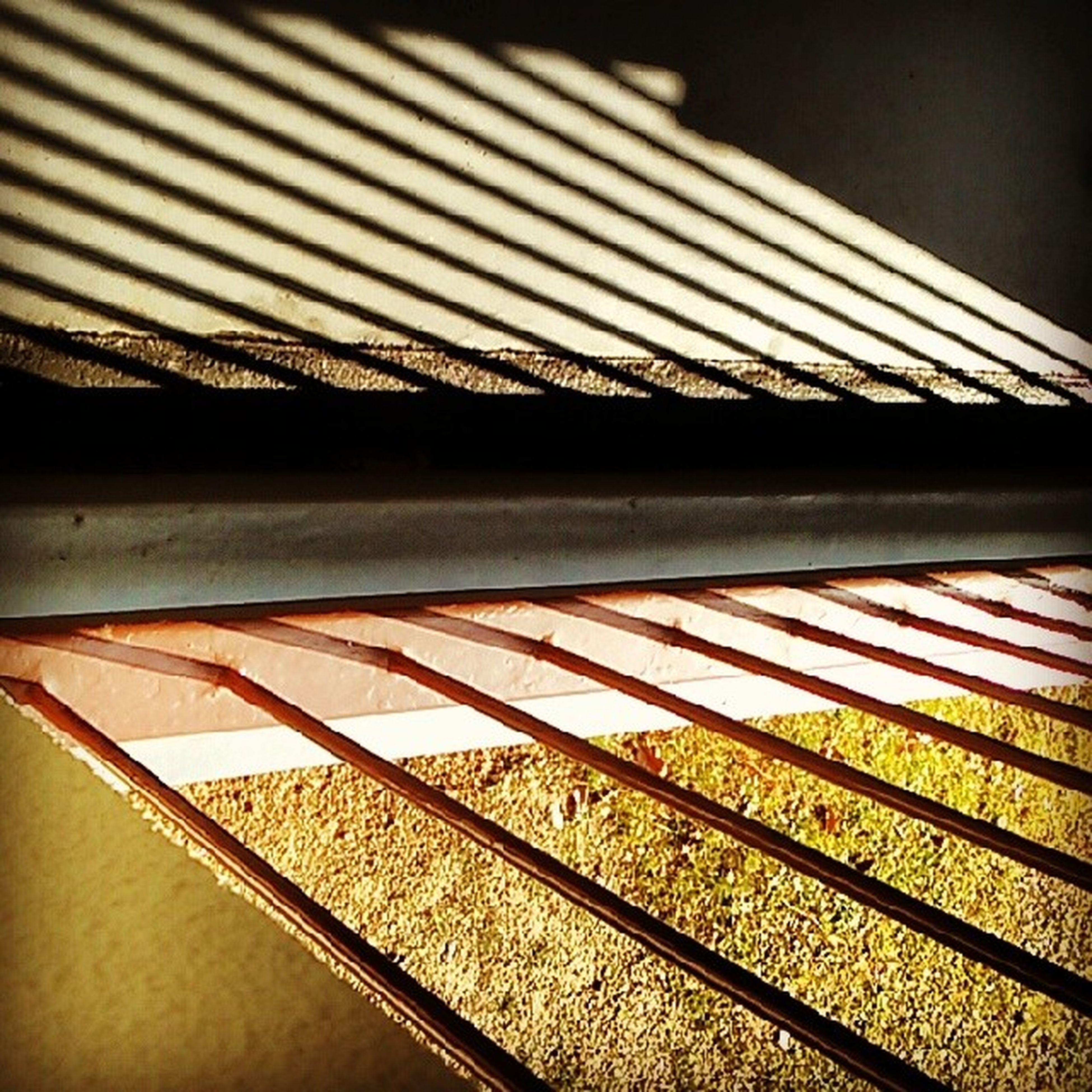 indoors, close-up, metal, pattern, no people, railing, high angle view, roof, focus on foreground, part of, selective focus, day, detail, metallic, still life, glass - material, railroad track, window, in a row