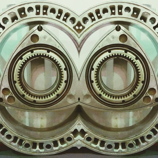 The OO Mission Taking Photos Check This Out Rotary Car Parts Mirrored Image Mirrored Rotary Engine EyeEm Gallery EyeEm No People Holes Random Shapes Engine Transportation Garage Auto Auto Automobile Parts Mechanic Photoshop Edited Side By Side Mazda