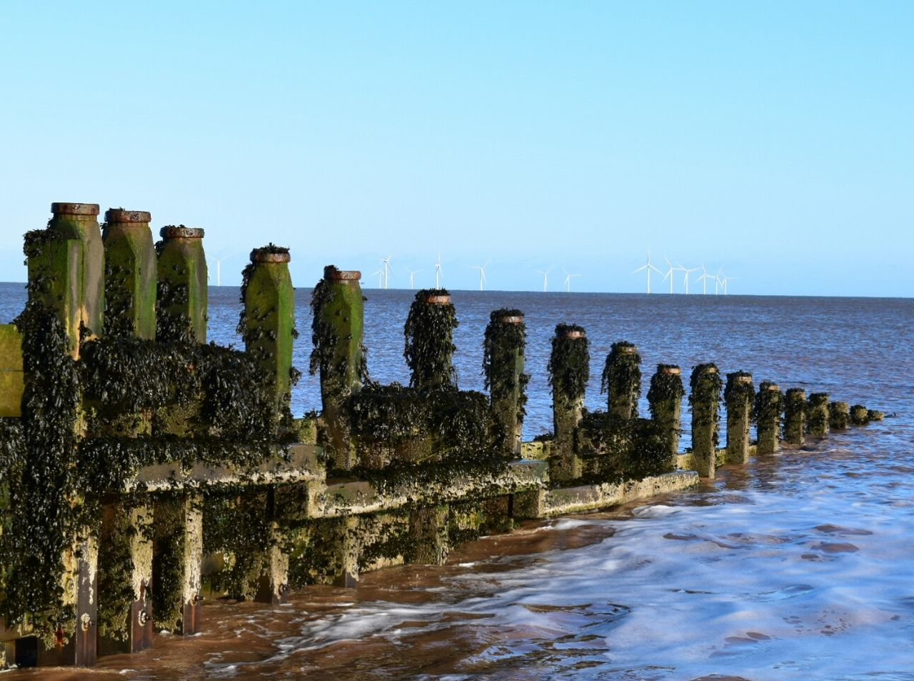 Old and new Withernsea East Yorkshire Sea Turbines Wind Turbines Groyne The Place I've Been Today Blue Wave