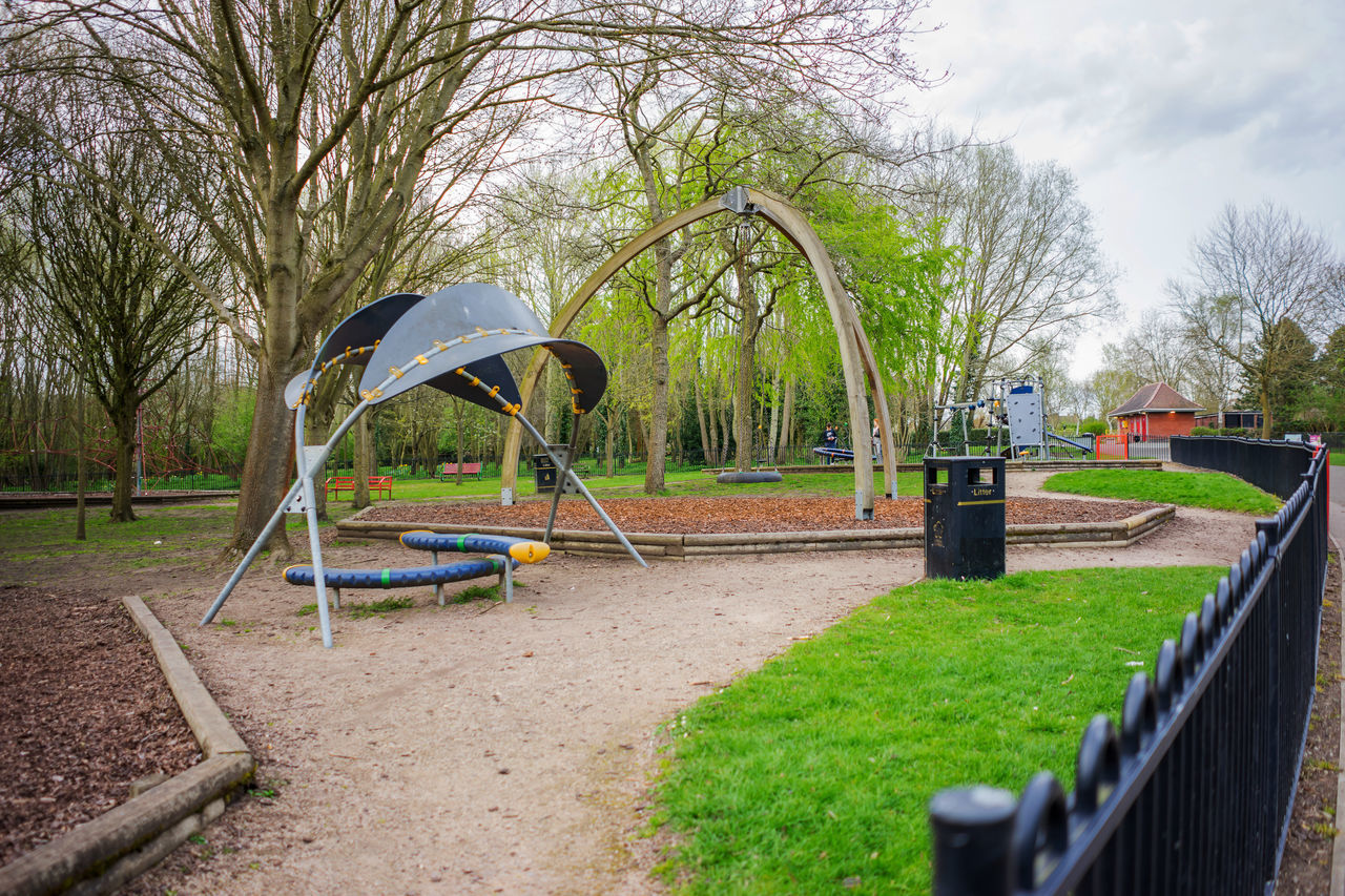 Play area in a park in the UK. Children Play Area Countryside Daytime Grass Lush Foliage Outdoors Outside Photography Park Plants Play Area Rural Scene Springtime Trees Wrought Iron Railings