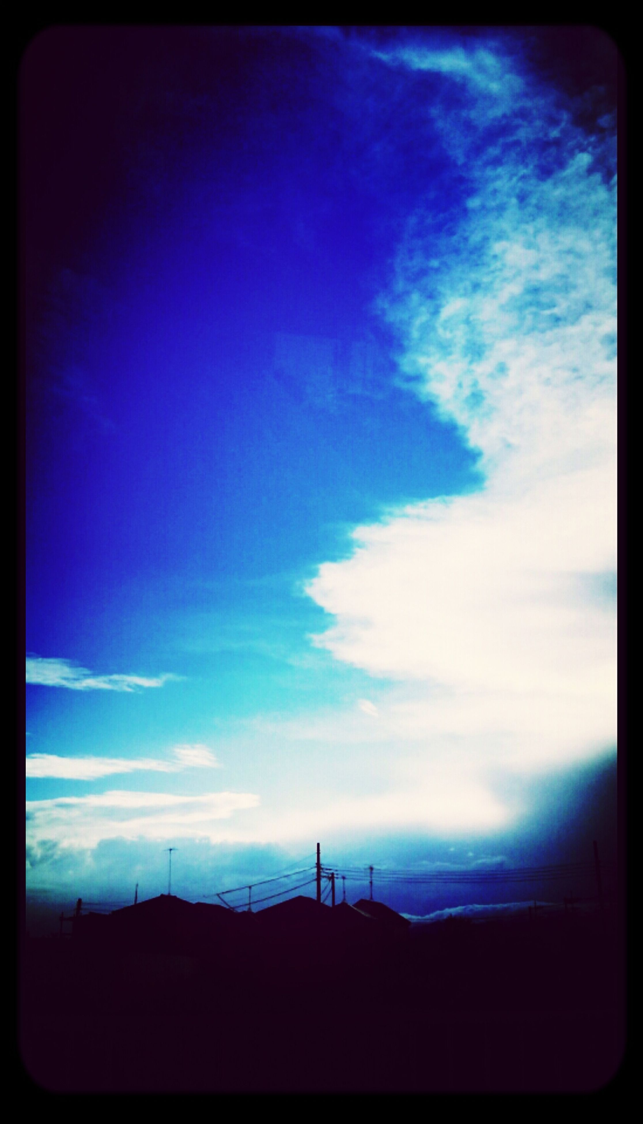 silhouette, transfer print, sky, auto post production filter, blue, low angle view, cloud, cloud - sky, dusk, beauty in nature, built structure, scenics, tranquility, nature, tranquil scene, sunset, electricity pylon, power line, outdoors, landscape