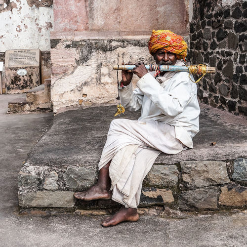 An old flute artist playing his flute to earn money. First Eyeem Photo Traditional Culture Music History Oldman