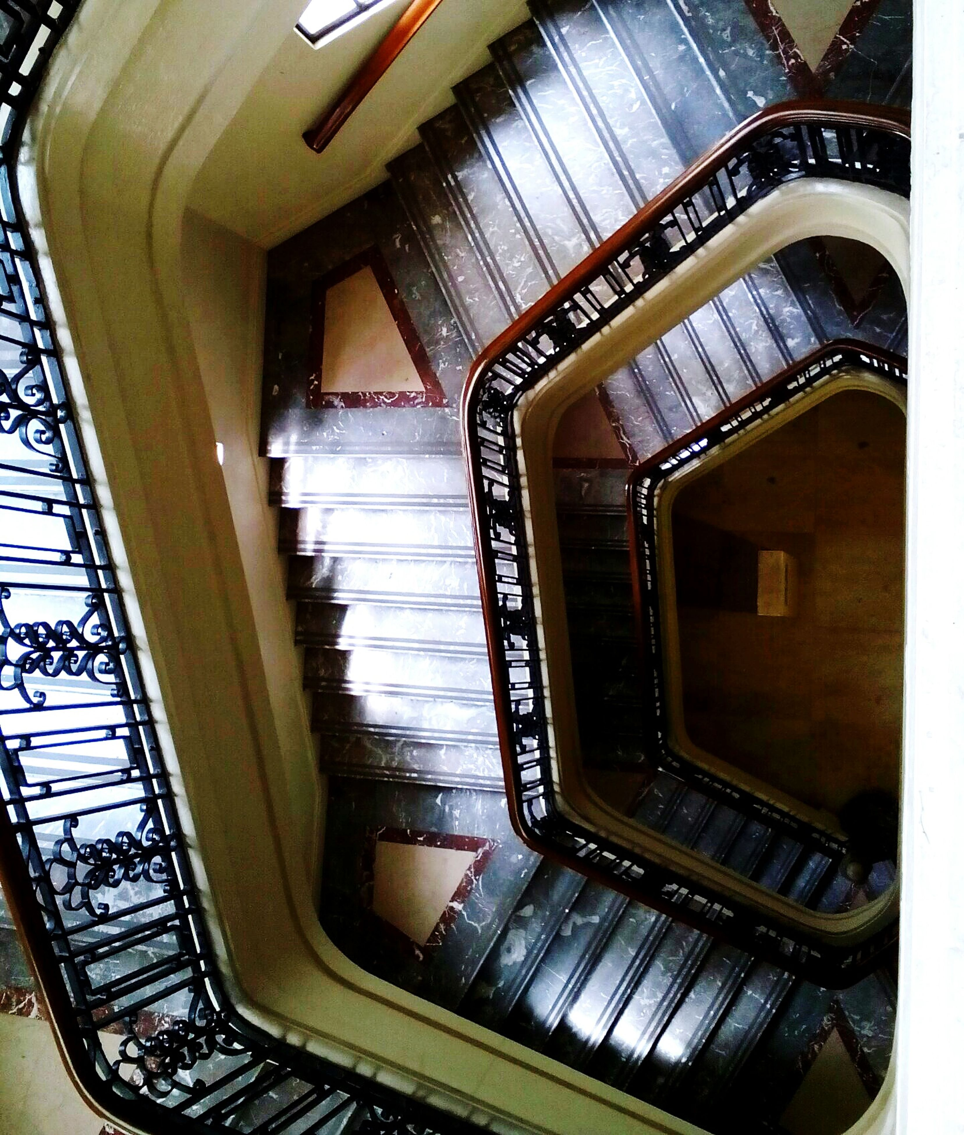 indoors, railing, staircase, steps and staircases, steps, spiral staircase, spiral, hand rail, day, steps and staircase, diminishing perspective, railings, no people, building story, interior