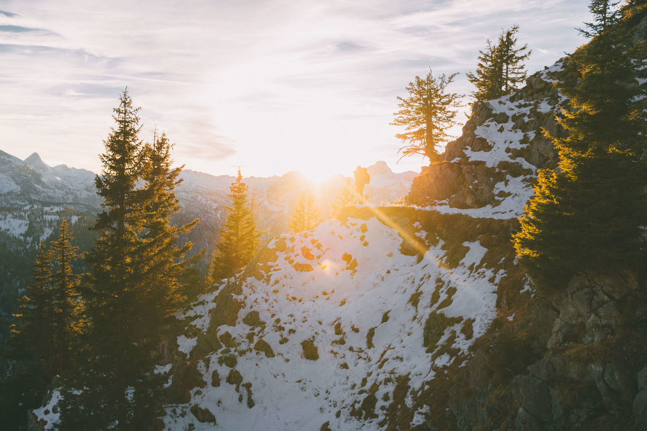 Sunset in the mountains with person silhouette in winter Beauty In Nature Cloud - Sky Day EyeEm Best Shots EyeEm Gallery EyeEm Nature Lover Forest Landscape Landscape_Collection Landscape_photography Mountain Nature No People Outdoors Person Silhouette Sky Sun Sunbeam Sunlight Sunset Travel Travel Destinations Tree Winter