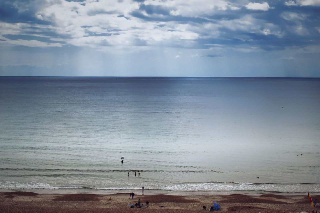 beach, sea, horizon over water, sky, cloud - sky, scenics, nature, tranquil scene, sand, beauty in nature, water, tranquility, shore, outdoors, beach volleyball, day, vacations, sport, no people