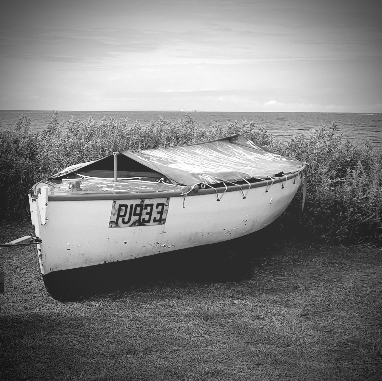 Nautical Vessel Water Day Outdoors Moored Sea Beach Grass Nature No People Sky Horizon Over Water