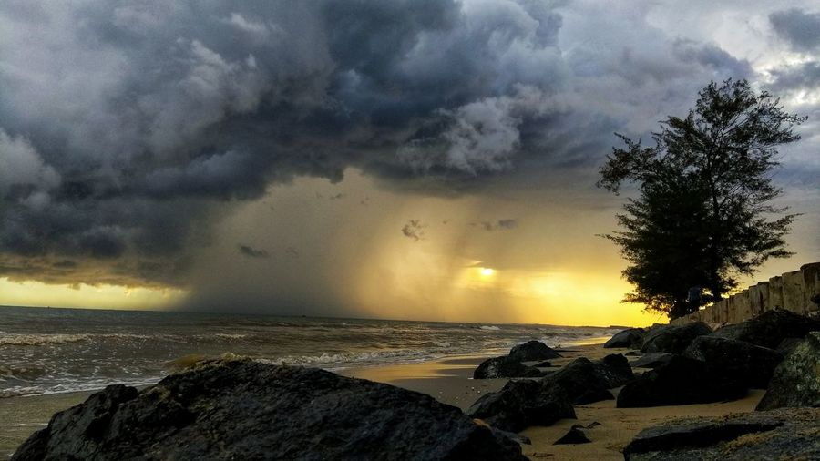 Little Beach Strom in Sunset EyeEm Phone Photography EyeEmNewHere EyeEm Indonesia PhonePhotography Sea Beach Horizon Over Water Cloud - Sky No People Nature Sunset Outdoors Beauty In Nature Storm Cloud Sky