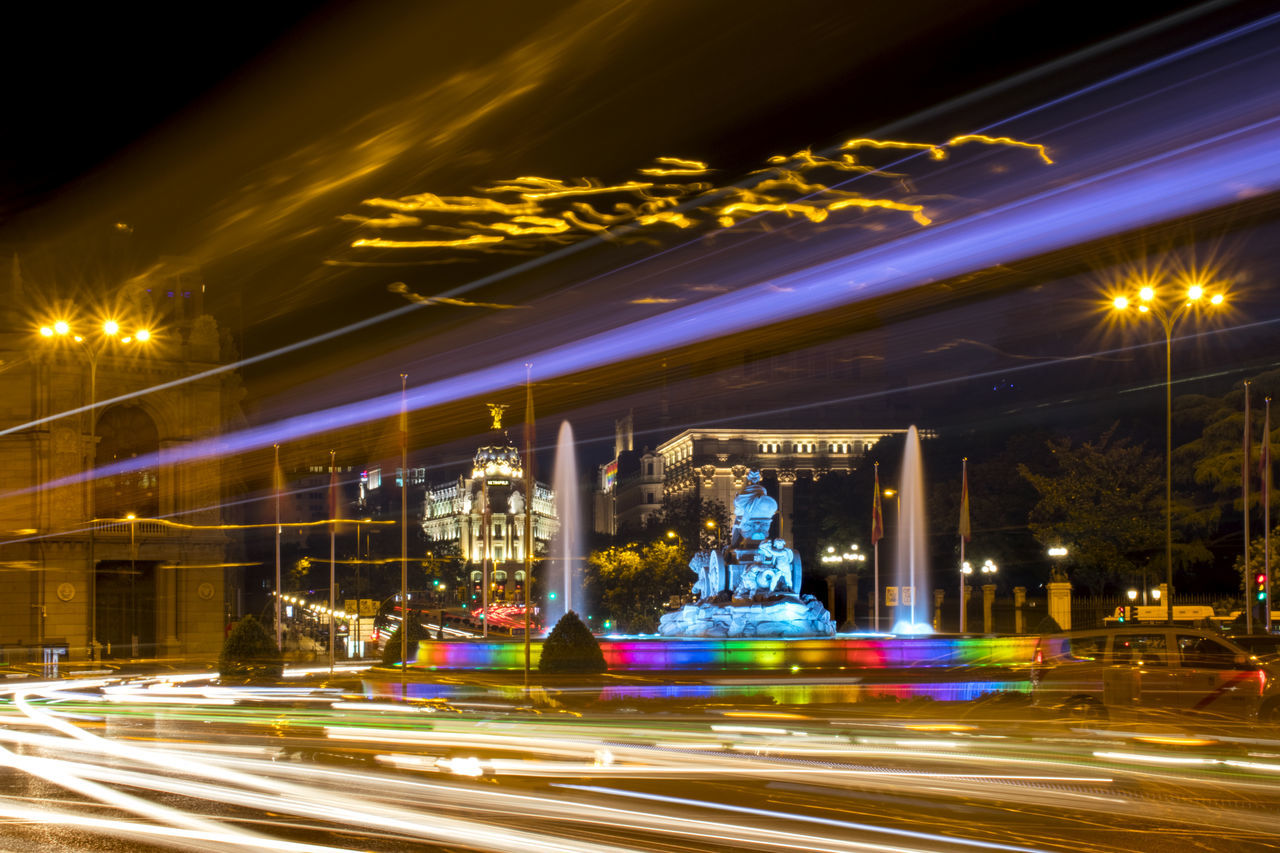 Architecture Blurred Motion Building Exterior Built Structure Carousel Cibeles City Colorful Fountain High Street Illuminated Lgbt Light Trail Long Exposure Motion Night No People Outdoors Pride Road Speed Street Street Light Transportation Urban Scene
