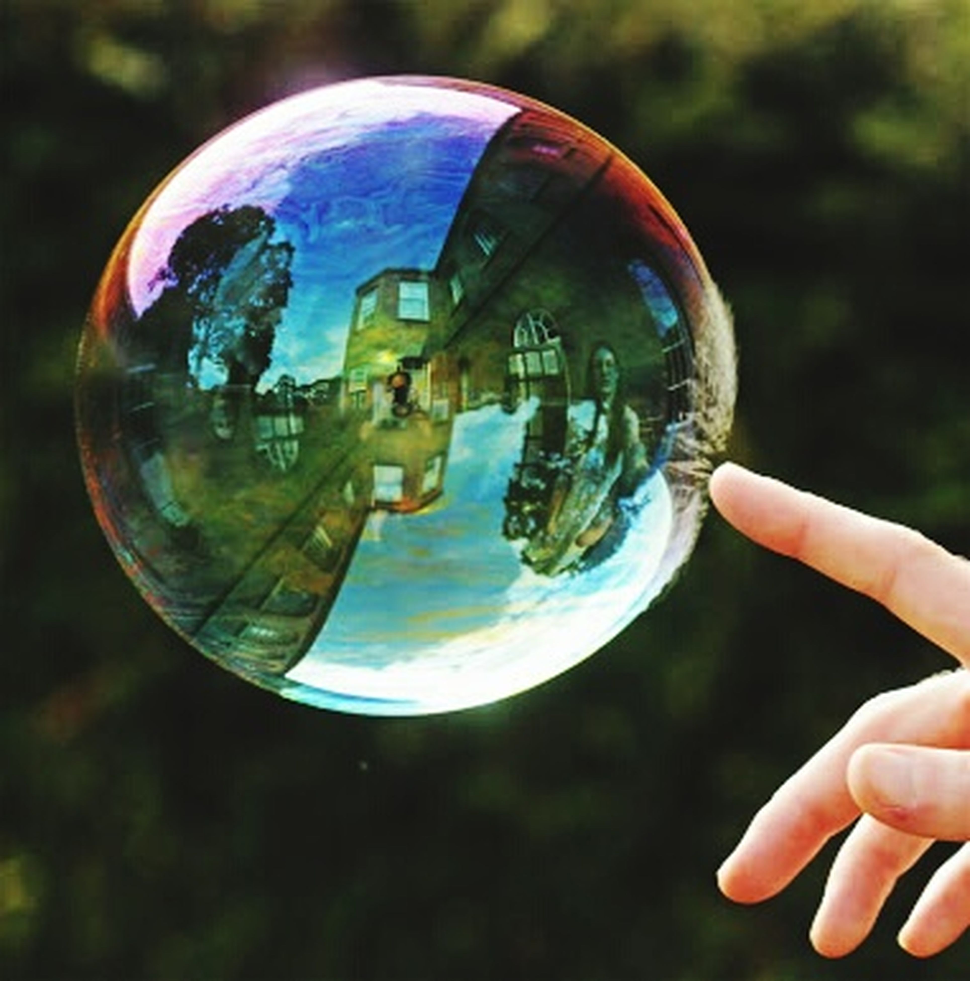 person, focus on foreground, transparent, part of, holding, close-up, bubble, mid-air, glass - material, unrecognizable person, cropped, leisure activity, human finger, lifestyles, reflection, water, sphere