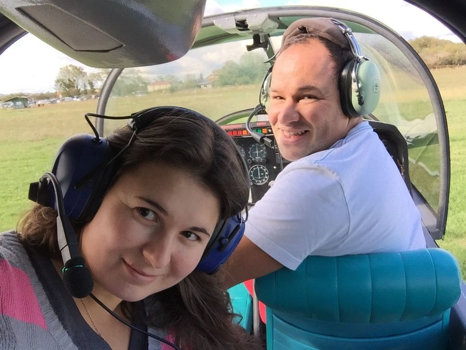 Two People Family Togetherness Leisure Activity Transportation Bonding Outdoors Smiling Driving Sport Real People Golfer Plane Airplane Females Happiness Women People Portrait