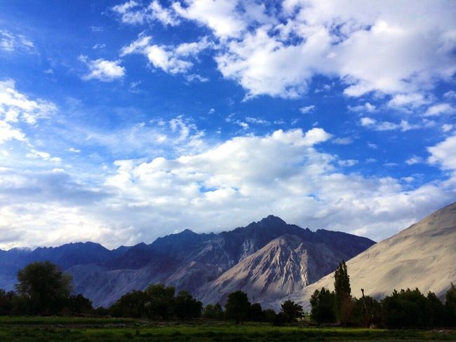 Mountain Tranquil Scene Scenics Landscape Tranquility Beauty In Nature Non-urban Scene Mountain Range Sky Nature Cloud Solitude Remote Majestic Day Countryside Physical Geography Outdoors Blue Cloud - Sky India Ladakh Hundur JammuandKashmir