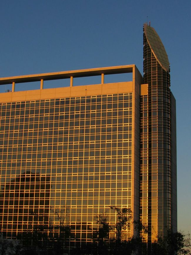 Architecture Built Structure Building Exterior Sunset On Building Against Blue Sky Trees Silhouette Reflection From A Distance Photography