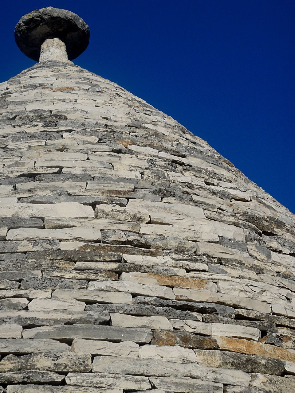 low angle view, clear sky, mountain, no people, outdoors, day, nature, architecture, ancient civilization, sky