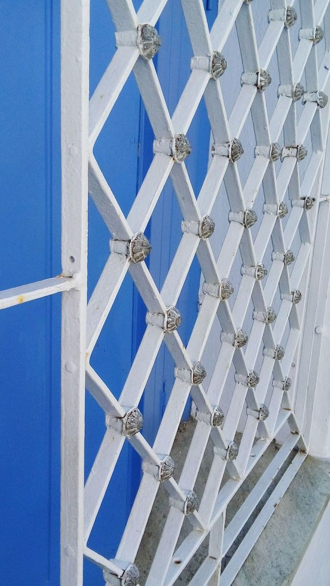Doors Backgrounds Full Frame Pattern Architecture Built Structure Blue Wall - Building Feature Design Repetition Building Exterior Day Modern Geometric Shape No People Patterned Architectural Feature Architectural