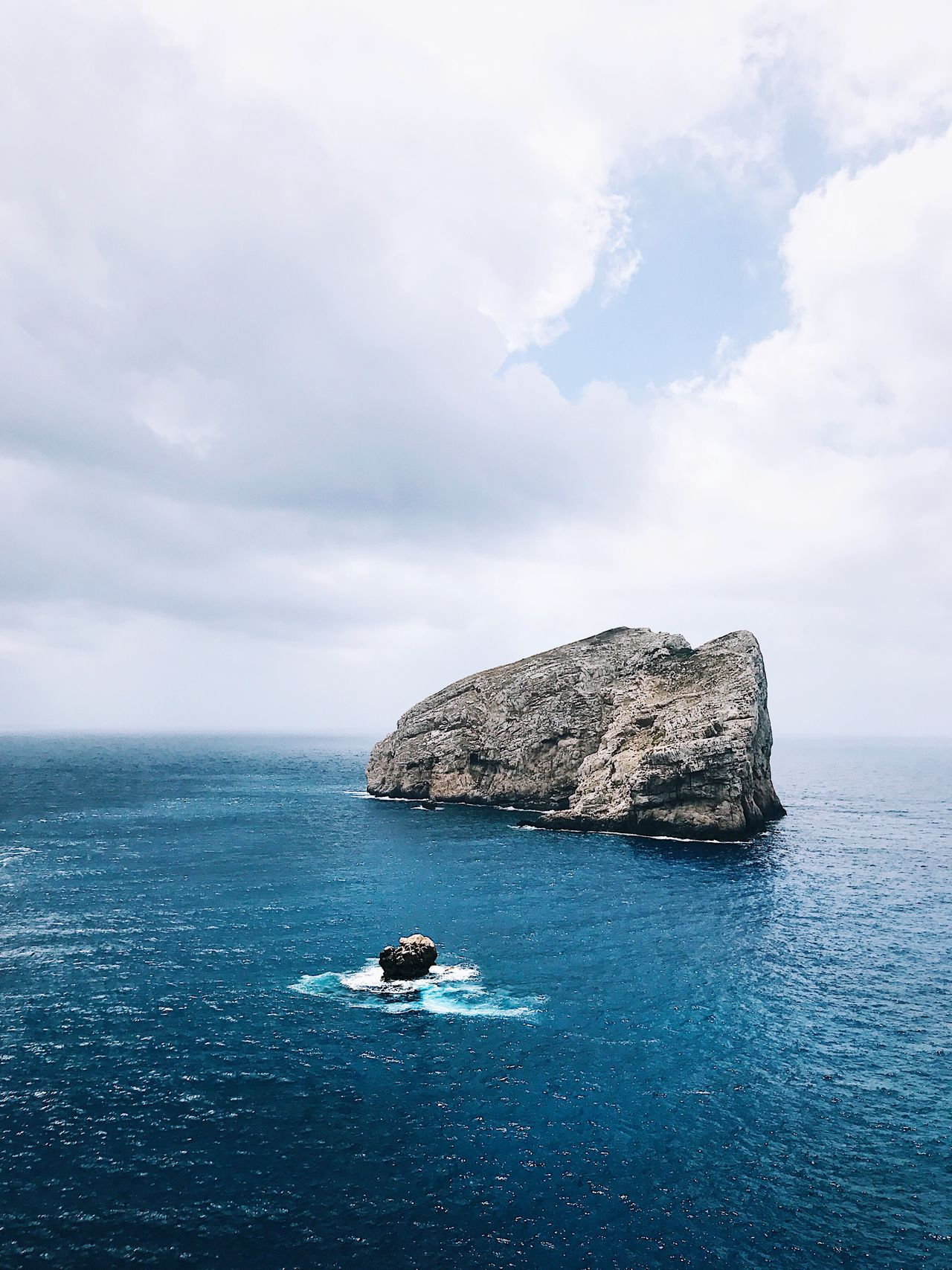EyeEm Selects Sea Water Sky Nature Rock - Object Beauty In Nature Scenics Tranquility Rock Formation Horizon Over Water Cloud - Sky Tranquil Scene Day Outdoors Cliff No People
