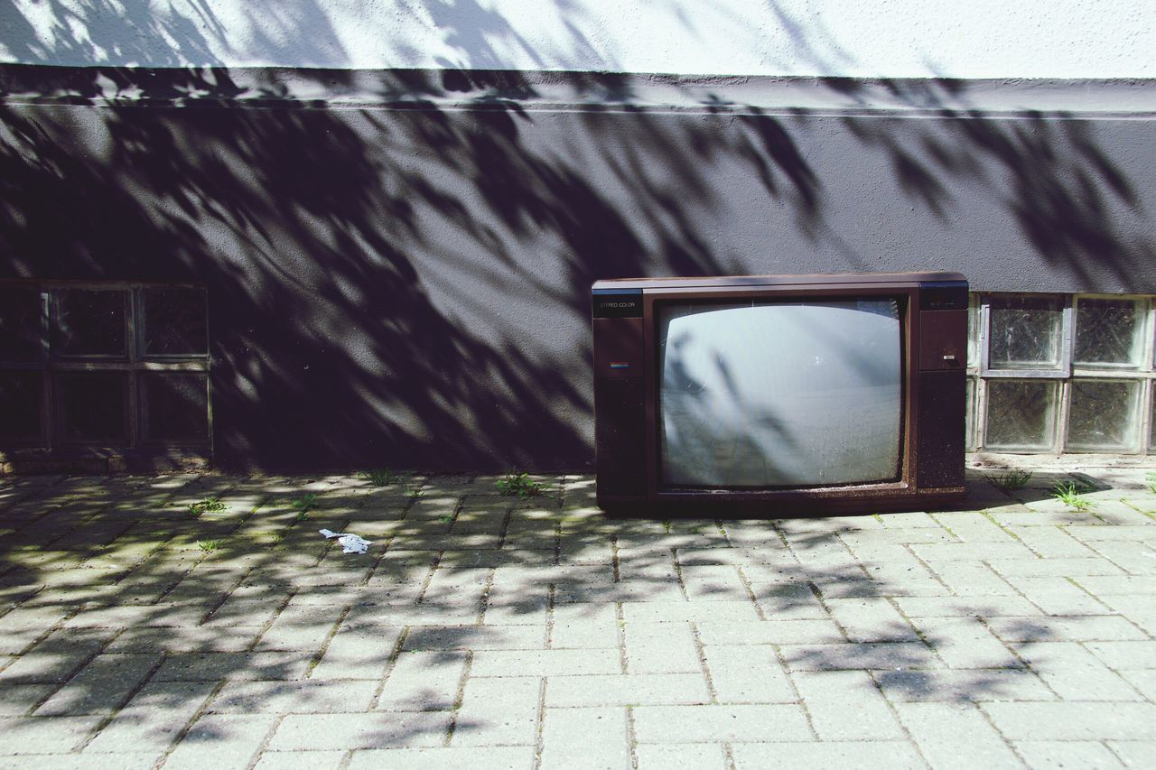 television set, day, no people, architecture, the media, outdoors, close-up
