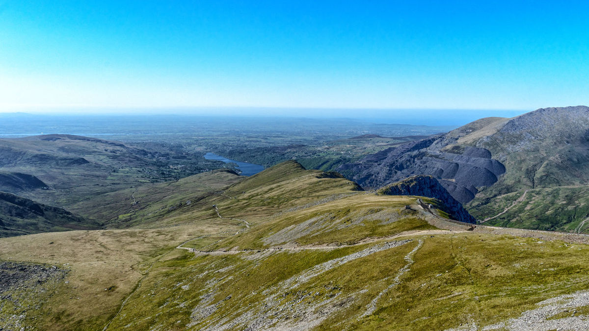 Beauty In Nature Blue Clear Sky Clear Sky Day Geology Grass Hill Horizon Over Land Landscape Majestic Mount Snowdon Mountain Mountain Range Nature No People Outdoors Rugged Sky Snowdon Snowdonia Tranquil Scene Travel Travel Destinations Wales