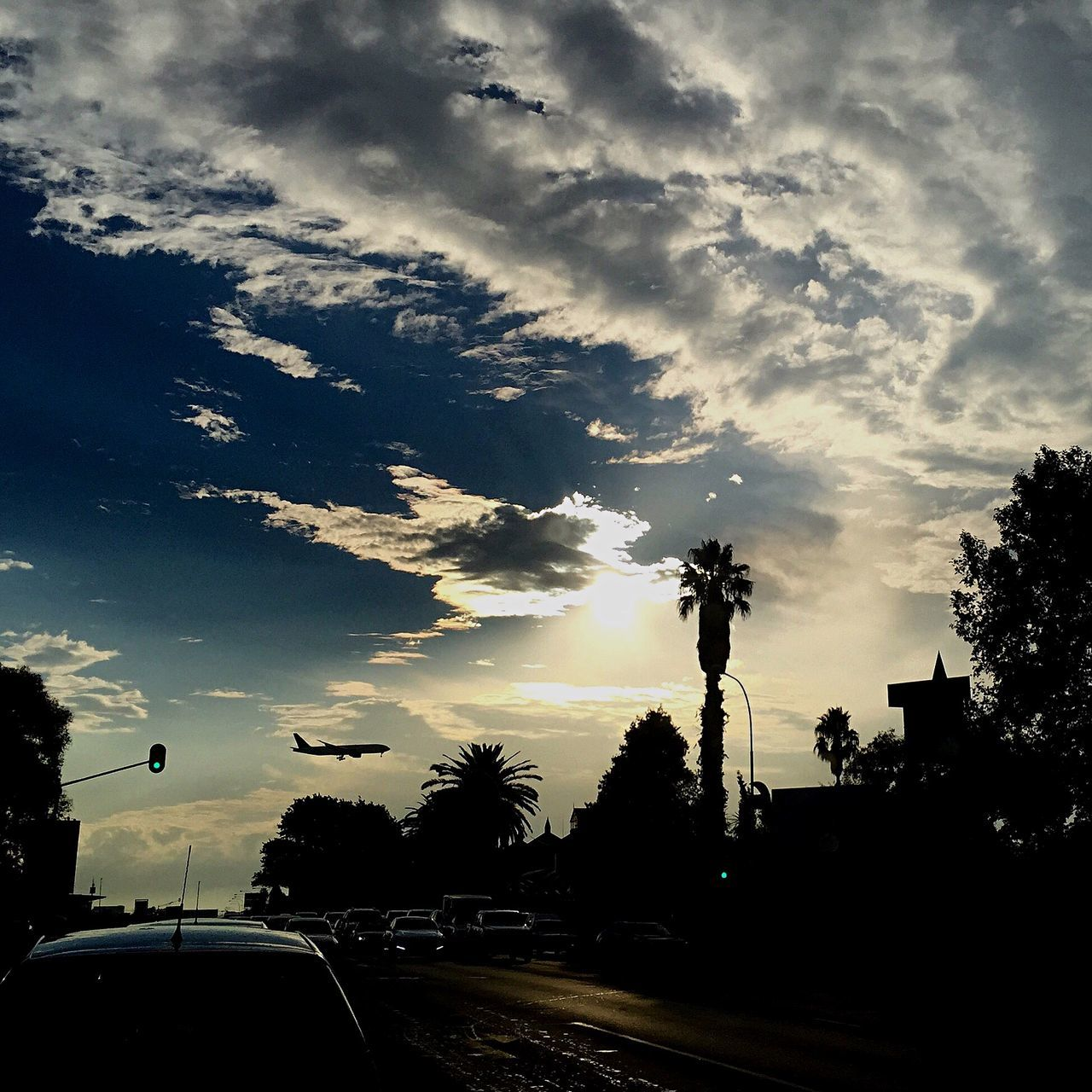 car, cloud - sky, sky, tree, silhouette, transportation, land vehicle, road, no people, sunset, street light, outdoors, city, nature, day