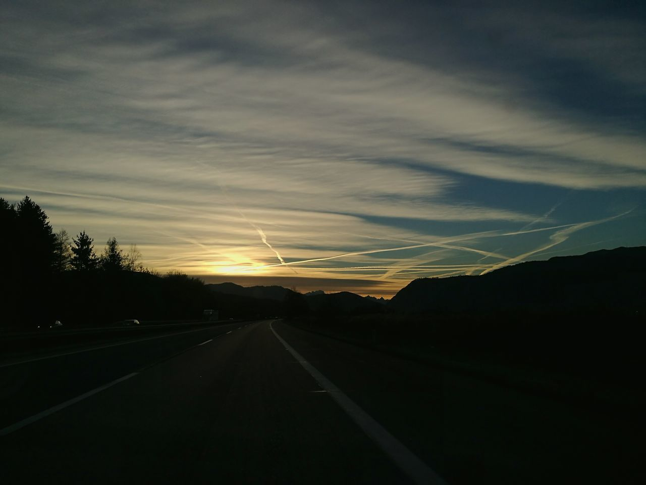 Road The Way Forward Transportation Travel Tree Cloud - Sky Highway Sunset Driving Journey Scenics Sky No People Beauty In Nature Landscape Winding Road Speed Night Outdoors Motion thinking it over