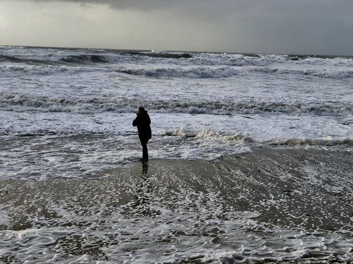 Watching the waves Rough Sea Stormy Weather Unpredictable Ankle Deep In Water Beach Beauty In Nature Danger Motion Nature One Person One Person Standing Outdoors Real People Sea Standing Water Wave Waves Rolling In