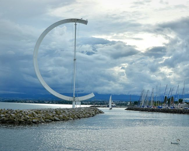 Walk in Lausanne . Leman Lake Switzerland Ouchy Lake Sculpture Sculpture On Water Reflections In The Water Water Surface Clouds Sea And Sky Peaceful Moment Harbor Eole Urban Landscape